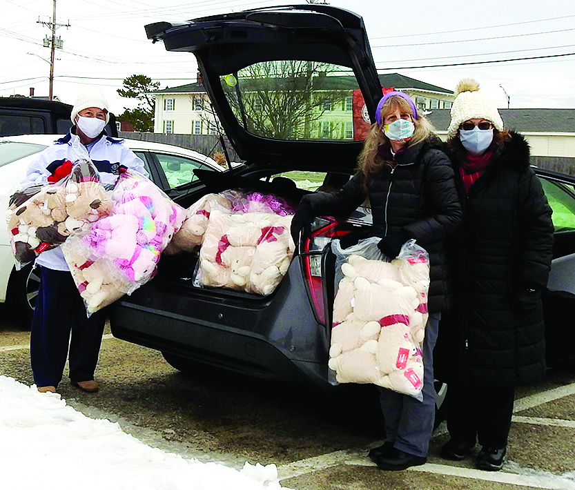 Stephanie Landry, Kim Wolfe-Greaves and Laura Breault unload a plush surprise.