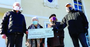 Hull Artists accepting check from Social Service League of Cohasset