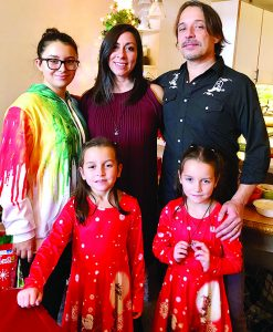 Lili Hedrick with her husband, Gary, and their twin daughters (top photo), Chloe and Verona, left to right Bottom photo, Lili Hedrick with husband, Gary, stepdaughter, Dahlia (15), and twins, left to right, Chloe and Verona (7)