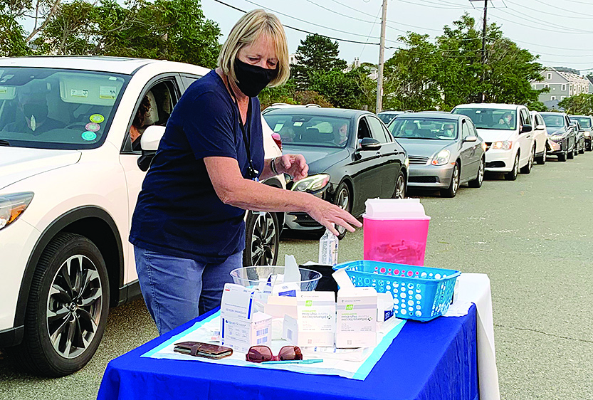Hull Health Director Joyce Sullivan, RN, pictured at one of the drive-through flu vaccine clinics that she organized and administered for Hull residents last September. [P. Abbate photo]