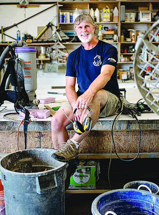 peter somers sitting in his concrete workshop