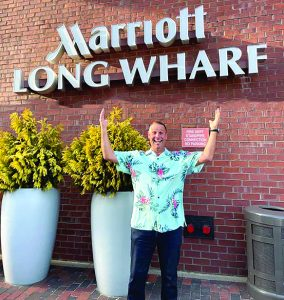 Jimbo Leahy standing in front of the Marriot Long Wharf in Boston Massachusetts