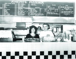 John and Sophia standing inside Josephs Pizza in Hull MA