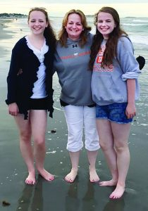 IN THE SPOTLIGHT. Actress Kelly Hines poses with daughters Amelia (left) and Abby Browne, on Nantasket Beach, one of the shooting locations for a new sitcom. [Courtesy photo]