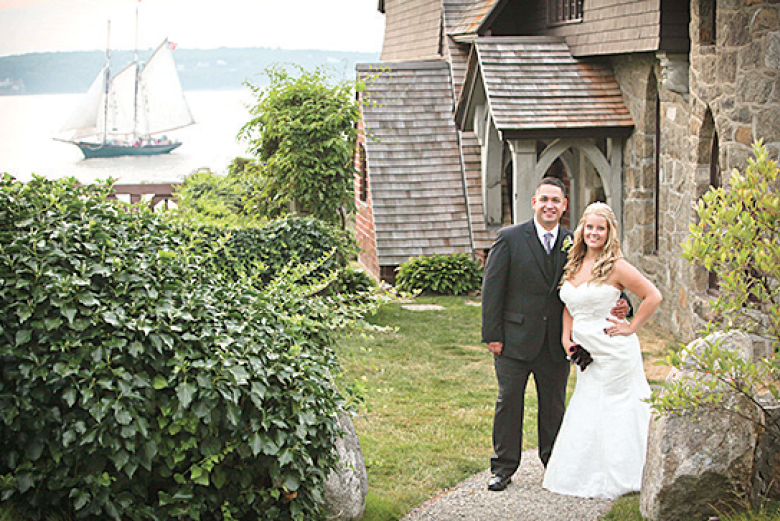 Lauren Victoria Gould standing with husband at church near sea