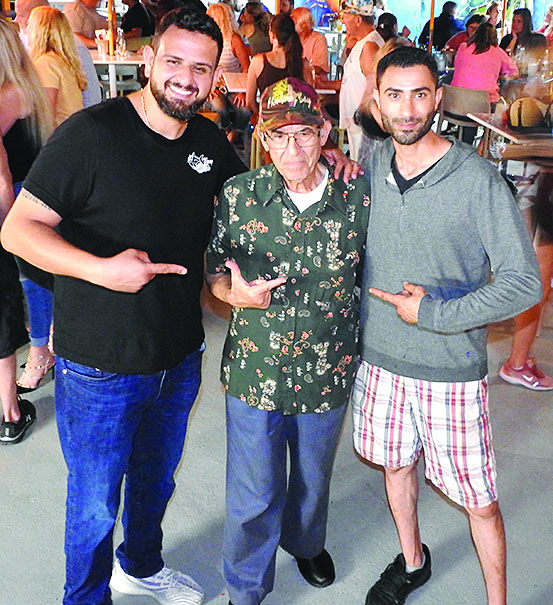 A TUNA TALE. Freddy Elkhoury, at left, and Anthony Ghosen, right, are joined by Benedetto Gattonini during the opening of their new eatery, Tipsy Tuna.