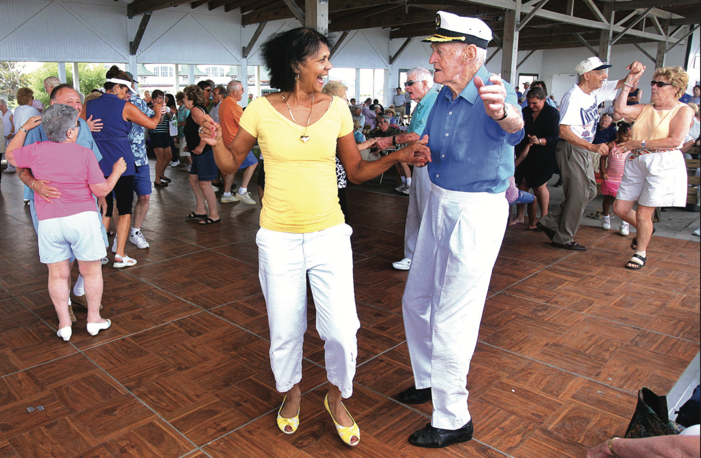 SWINGING THE SUMMER AWAY. This photo, taken more than a decade ago, expresses the joy that live music brings to those who travel to the Bernie King Pavilion to enjoy familiar melodies by the sea during the summer. [Tom Herde Hull Times file photo, 2007]