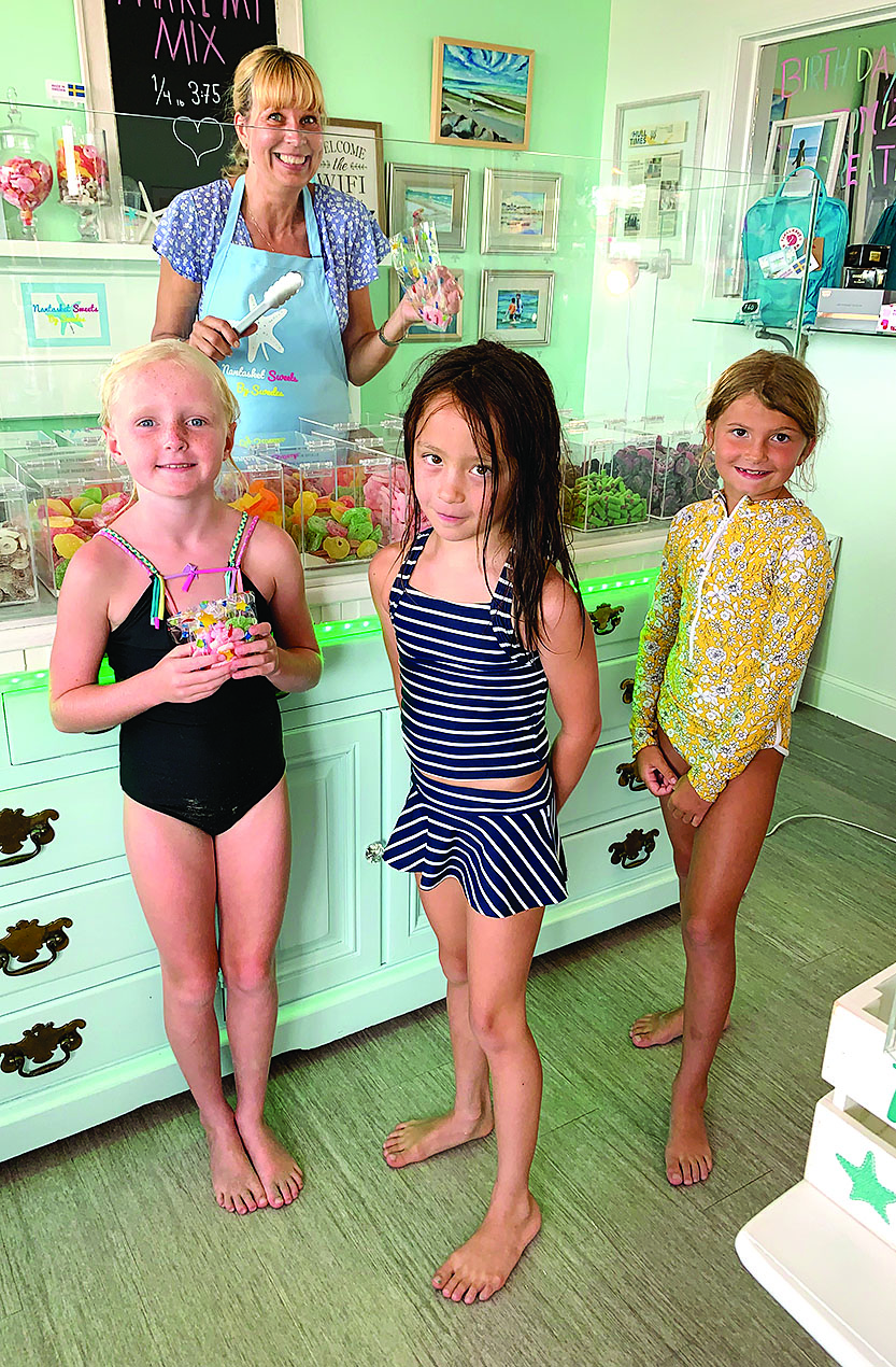 kids standing at candy counter