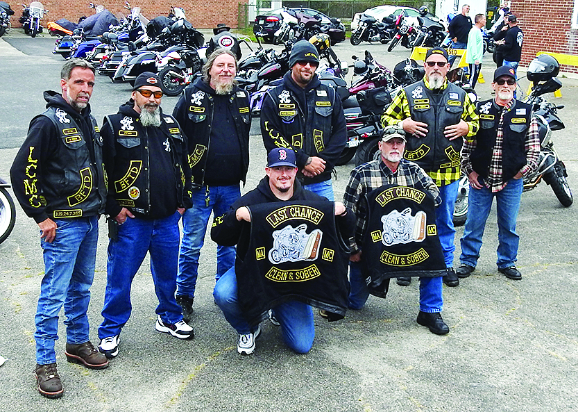 standing group of bikers with jackets that say Last Chance Clean & Sober